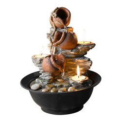 "Jeco - Tavolo Luci Mini Pot Tabletop Fountain with Candle - ""Enjoy the soothing sounds of nature in miniature, with this handsome mini pot table fountain. With three built-in removable tealight candles that give off a beautiful glow, pairing a trio of pitchers with faux rock formation and the simplicity of the bowl that holds it all. Quietly distinctive and esthetically pleasing, a fountain provides both moisture for the dry air of your office or home, as well as the gentle white noise of running water for relaxation and stress relief. A great gift for the busy executive. Resin and Plastic."