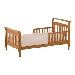 Storkcraft - Soom Soom Toddler Bed in Oak Finish - This beautifully crafted toddler bed features an oak finish and durable wood construction to last for ages without losing style or function. Comes with side rails and fits a standard crib mattress, making the move from crib to big kid bed easier for you and your child.