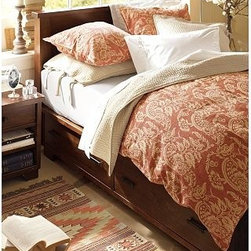 "Sumatra Storage Bed, King/Cal. King, Mahogany stain - With its rustic hardwood richly finished in a mahogany stain and generous under-bed drawers, the Sumatra Storage Bed is a smart solution for keeping the bedroom stylish and organized. Rustically beautiful knots, burls, whorls and dings add to the inherent beauty of this piece. Expertly crafted solid hardwood frame. Storage bed features four under-bed drawers that operate on smooth wooden glides. The platform bed has thick posts and legs, and a headboard topped with molding. The use of a slat-roll support system makes a box-spring optional. Hand-sanded edges add to the distressed look. Final coat of lacquer is applied by hand for lasting beauty. Wood swatches, below, are available for $25 each. We will provide a merchandise refund for wood swatches if they're returned within 30 days. View and compare with other collections at {{link path='pages/popups/bedroom_DOC.html' class='popup' width='720' height='800'}}Bedroom Furniture Facts{{/link}}. Full/Queen Storage Bed: 61"" wide x 84"" long x 46"" high King/Cal. King Storage Bed: 77"" wide x 88"" long x 46"" high View our {{link path='pages/popups/fb-bedroom.html' class='popup' width='480' height='300'}}Furniture Brochure{{/link}}."