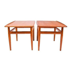 Pre-owned Grete Jalk Teak End Accent Tables - A Pair - A pair of classic Danish Modern end tables by Grete Jalk. The tables are constructed of solid teak with beautiful wood grain. The raised lip edges are characteristic of Jalk's designs. What a great pair!