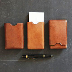 Sleek Leather Business Card Case - Your business cards are the first impression many people have of your business--don't they deserve a handsome home? This case is a fine and fitting addition to your desk in slick tobacco-toned leather. It arrives in a drawstring bag for safekeeping before it's put to use.