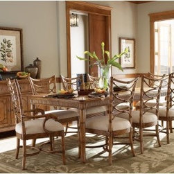Tommy Bahama by Lexington Home Brands Beach House 9 Piece Boca Grande Dining Set - Coastal design elements and Caribbean styling come together in the Tommy Bahama Home Beach House 9 pc. Boca Grande Dining Table Set making it a charming addition to any dining space. Boasting an exotic mango veneer top with reeded bamboo design on the apron this rectangular dining table comes with one 22-inch leaf so you can easily extend the table's length from 68 to 90 inches seating up to eight guests at a time. This means that whether you have family over for dinner or are entertaining friends you can easily accommodate them at your table! A warm umber finish perfectly compliments the table's casual yet upscale appeal while sturdy construction from select hardwoods and mango veneers makes this table a part of your home for years to come. To compliment the set includes 8 rattan chairs with upholstered seats in tan and ivory textured fabric. Includes 2 arm chairs and 6 side chairs. Table dimensions: 68-90L x 44W x 30H inches. Chair dimensions: 22.5W x 23.5D x 40.75H inches. About Tommy Bahama HomeTommy Bahama started as an upscale men's casual sportswear line and has transformed into a signature brand expanding their product line to accommodate women's apparel golf wear footwear home furnishings and even retail and restaurant compounds. The Tommy Bahama brand represents quality products with fashion forward designs that are available at an affordable price. Their signature island-lifestyle designs suggest a modern style with an emphasis on comfort and relaxation.