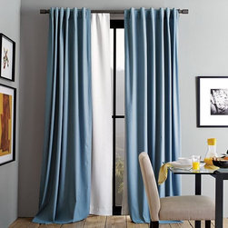 New Blackout Window Panel - Lights out. Designed to layer under lighter curtains, this dense drape blocks light, absorbs noise and insulates against heat and cold. By blocking sunlight, it also protects curtains, rugs and furniture from fading.