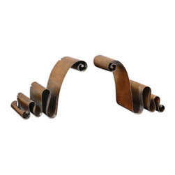 Uttermost - Ribbon Bookends Set of 2 - Give these cool, curvy bookends a rave review. Crafted of distressed metal with a copper-bronze finish, they'll hold your favorite tomes with distinctive style.