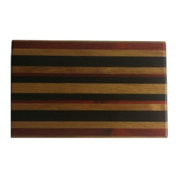 "Exotic Chopping Blocks - 8"" x 12"" Cutting Board - The simplicity of this board allows the woods to shine. The wood highlighted in this board is the yellow Canary, which comes from South America. the other colors seen are the black pieces of Wenge from Africa and Padouk form South America. All the woods are their natural colors. There has been no paint or stain added."