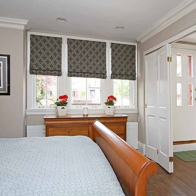 Scott R. Clark - Flat Roman Fabric Shades with blackout lining and mounted outside the window opening to allow less light.