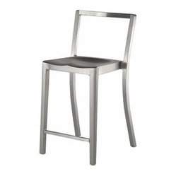 "Emeco - Emeco Icon Counter Stool | YLiving - Design by Philippe Starck.By Emeco.""When I close my eyes, this is the chair I see,"" Philippe Starck. 100% Aluminum. Guaranteed for life. What more do you need? Handmade from 80% recycled aluminum. Designed to last for 150 years. The Icon Counter Stool is tempered for ultimate strength in a proprietary three-step process. Emeco is the only company in the world to do this. Sculptural, spare, versatile. Emeco's Icon Counter Stool: for a finishing touch at tall tables and counters. The spare silhouette features a curved backrest, entirely open below. A shaped seat meets the tapered legs at sharply turned angles. Select from Hand Brushed and Hand Polished finishes."