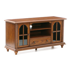 Holly & Martin - Highbanks Media Stand - Finished with an exquisite antique oak stain, this traditional TV stand is ideal for even your newest media additions. Spiraled dowel accents on each side frame the unit while arched-top windowpane doors open to reveal a removable shelf on each side. These shelves are ideal for storing movies, games, or even game consoles once the shelves are removed. In the center lie two shelves that make room for your receiver and media player with cord management access right in the middle. Finally, a useful storage drawer pulls out on the bottom that provides the perfect solution for unsightly items like game controllers and extra cords. Add this media stand to your room for a traditional appeal that still accommodates all of the modern necessities.