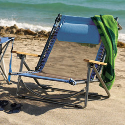 Frontgate - Breezy Beach Recliner - Lightweight aluminum frame folds compactly for easy transport. Adjust to 5 positions (including fully flat). Wood armrests and cording details for additional style and comfort, plus a carrying strap for easy transport. Includes a height-adjustable pillow. A Frontgate exclusive. Our extremely lightweight Breezy Beach Recliner is the best way to stay cool and comfortable while lounging near the ocean or pool. This recliner's seating surface is made from breathable and quick-drying Duramesh that allows air to circulate freely, keeping you cool, even on the warmest days.  .   .  .  .