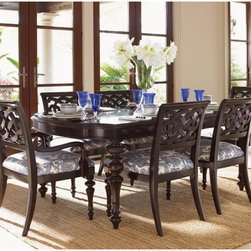 Tommy Bahama - Tommy Bahama by Lexington Home Brands Royal Kahala Islands Edge Dining Table Mul - Shop for Dining Tables from Hayneedle.com! If you want to enjoy the best of elegant island living the Tommy Bahama Home Royal Kahala Islands Edge Dining Table will not let you down. Named after the spectacular oceanfront enclave on the island of Oahu this table boasts distinctive British Colonial carved details on the legs which play up its eclectic mix of casual contemporary and upscale charm. It comes with two leaves so you can easily extend the table's length from 80 to 120 inches seating up to 10 guests at a time. This means that whether you have family over for dinner or are entertaining friends you can easily accommodate them at your table! Finished in rich tones of dark coffee this dining table is sturdily constructed of select ribbon-striped mahogany and mahogany veneers for a look that's as elegant as it is enduring. About Tommy Bahama HomeTommy Bahama started as an upscale men's casual sportswear line and has transformed into a signature brand expanding their product line to accommodate women's apparel golf wear footwear home furnishings and even retail and restaurant compounds. The Tommy Bahama brand represents quality products with fashion forward designs that are available at an affordable price. Their signature island-lifestyle designs suggest a modern style with an emphasis on comfort and relaxation.