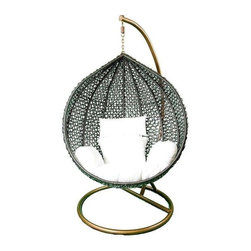 Hanging Black Rattan Chair White Cushions - A waterproof synthetic plastic rattan hanging chair with white cushions, so leisurely that it takes you back to the tropics! The rattan teardrop shaped form creates the space for a cozy nest of cushions and hangs from a rust resistant iron frame. It is a striking example of high design for your indoor or outdoor living space. Rattan is tailored for those who appreciate upscale furniture design with a tropical edge.