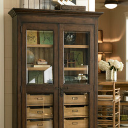 Universal Furniture - Paula Deen Dish Pantry in Molasses - Looking for a China cabinet change-up? Then the Paula Deen Dish Pantry, by Universal Furniture, is for you! Behind the beautifully wood-framed doors lies an abundance of storage. Eight interior tray drawers, with silverware tray inserts in the top, provide ample space for even the most expansive serving sets! The slatted back, poplar veneers, and weathered molasses finish combine to give this piece an old-world feel without sacrificing modern functionality.