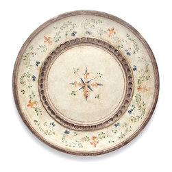 Medici Round Platter - A band of details stamped by hand into bisque-colored ceramic and an edging of indigo flowers gracefully daubed onto slim, trailing green vines contrast delicate grace with a sterner, more assertive handcrafted look in this Medici Round Platter. Heraldic symbols in faded gold add a touch of formality to the weight that makes this piece a pleasure to handle.