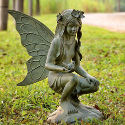 Fairy Garden Sculpture - Displaying beautiful craftsmanship and fine detail, our magical garden sculpture portrays a fairy gently kneeling while lovingly cradling a bird. At more than two feet tall, this wonderfully fantastical sculpture is certain to draw attention while its weather-resistant aluminum construction will endure the elements.