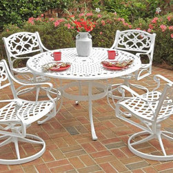 HomeStyles - 5-Pc Dining Set in White (48 in. Dia.) - Choose Size: 48 in. Dia.Includes round table and four swivel chairs. Powder coat sealed with clear coat to protect finish. Patterned table top. Center opening to accommodate umbrellas. Nylon glides on all legs. Made from cast aluminum. Seat height: 16 in. H. Chair: 24.4 in. W x 22 in. D x 33.46 in. H. Table: 42 in. Dia. x 29 in. H. Warranty. Table Assembly instructions. Chair Assembly instructions