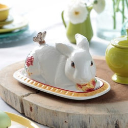 Fitz and Floyd Flower Market Rabbit Covered Butter Dish - A charming addition to your spring or Easter table, the Fitz and Floyd Flower Market Rabbit Covered Butter Dish is made from hand-painted earthenware in Italian rustic colors of Naples yellow and Sunset red. The floral and butterfly details of this butter dish bunny offer the superb realism of artisan-pressed surface textures, for a rustic chic style that's always in season.About Fitz and FloydFitz and Floyd is recognized worldwide as a leader amongst the style- and quality-conscious. For 50 years, their unique designs have made them the leader in the purveyor of hand-painted ceramic dinnerware, tableware, accessories, giftware, and collectibles. All Fitz and Floyd pieces are easy to spot. Each piece is distinctively hand-crafted by artisans, from the drawing board to the sculpting wheel and kiln.The company's Dallas-based studios are renowned for producing over 500 unique designs per year. Creations range from presidential dinnerware for the White House or a tea service for Her Majesty Queen Elizabeth II, to the perfect centerpiece for your table, and each design is lovingly crafted in the highest quality. Meticulous craftsmanship and exquisite detail make every Fitz and Floyd piece a treasured heirloom-quality gift.