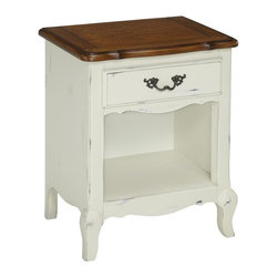 HomeStyles - Oak and Rubbed White Night Stand - The night stand is constructed of hardwood solids, engineered wood and oak veneers in a distressed oak and heavily rubbed white finish. The distressed oak features several distressing techniques such as worm holes, fly specking, and small indentations. Features include one storage drawer and one bottom shelf. Design features include shaped carved proud legs, raised corner peg accents, and detailed brass hardware. Assembly required. 23.75 in. W x 18 in. D x 28 in. H