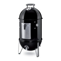 Weber - Weber Smokey Mountain Cooker Smoker - 14.5 in. - Black - 711001 - Shop for Smokers from Hayneedle.com! Delight in smokey delicacies hot off the Weber Smokey Mountain Cooker Smoker - 14.5 in. - Black. Its generous cooking surface rust-resistant construction and plated steel cooking grate complement a heavy-duty porcelain-enameled bowl lid and water pan making this smoker a backyard addition to last a lifetime. Classic black finish built-in lid thermometer and large charcoal chamber complete the package. About Weber GrillsWeber-Stephen Products Co. headquartered in Palatine Ill. is the premier manufacturer of charcoal and gas grills grilling accessories and other outdoor room products. A family-owned business for more than 50 years Weber has grown to be a leading seller of outdoor grills worldwide.
