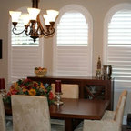 Ballard Residence - Arched top shutters make a memorable first impression in this dining room.  Shutters allow you to enjoy more light and view than a traditional wood blind.  Shutters are timeless and elegant.