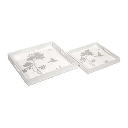 Meshaw Trays - Set of 2 - A brilliant white lacquered finish with a delicate silver leaf floral pattern give the Mershaw trays an elegant yet bold presence.