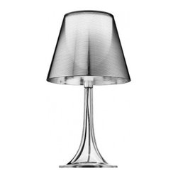 """Flos - Miss K table lamp - Product description:   The Flos Miss K table lamp is designed by Phillipe Starck for Flos.This table lamp is providing diffused light. The diffuser of this pretty table lamp is made from a fully transparent, injection-molded PMMA polymethylmethacrylate. The external diffuser is completelty finished with a high-vacuum aluminization process. The Miss K table lamp has a traditional dimmer for 0 to 100% luminosity adjustment with translucent cover fitted on the translucent polarized cord. In stock and ready to ship! UL listed!    Details:                                  Manufacturer:               Flos                                  Designer:               Phillipe Starck                                  Made in:              Italy                                  Dimensions:               Height H:17,01"""" diameter:9,29""""                                   Light bulb:               max. 100W incand.                                  Material               polymethylmethacrylate                        Flos is the Italian creator of contemporary light fixtures that was founded in 1962. THe light structures of the company can be found in many countries across the globe—in hotels, homes, restaurants, and more. They are also regularly featured at events and exhibits.  Miss K Table Lamp"""