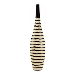Ore International 18H in. African Crafted Tall Vase - The African Crafted Tall Vase casts an exotic, designer spell in any room. This tall standing vase is carved of polyresin with a black and cream waved line pattern. Perfect designer piece for dressing up any room.About Ore International, Inc.Ore International, Inc. creates beautiful accent furniture, lighting, and gifts for the home. Their goal is to be the leading provider of innovative, superior home products worldwide. Ore International is based in Santa Fe Springs, California and has a Customer First attitude. Their products are designed to match modern and classic tastes and fit today's homes. From room dividers to lamps, end tables to entertainment centers, you'll discover quality craftsmanship at a fair price in all Ore International products.
