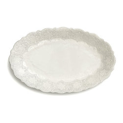 Merletto Antique Oval Bowl - Lace hints at a certain refinement in the home, an appreciation for the definition of elegance � and this association is perfectly timeless, at work in traditional rooms and transitional spaces alike.  Bring that allusion to the dinner table with the Merletto Antique Oval Bowl, an elliptical vessel framed in splendid scalloped texture with complex yet dainty floral motifs.