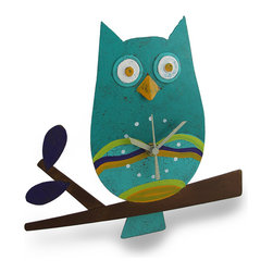 Teal Perched Owl Metal Art Pendulum Wall Clock - This adorable clock combines a cute crafty design with timekeeping utility for a remarkable collectible time piece. Hand crafted from recycled metal materials, the clock takes on a uniquely artistic shape as a charming owl perched on a fall branch. The body of the bird forms the clock face for a quartz clock movement with a tail-shaped pendulum swinging below. The clock runs on 1 AAA battery (not included). A modest hand-painted colorful finish completes the feel of home-style craftwork. The clock measures 10 1/2 inches wide, 9 1/2 inches tall, and 2 1/2 inches deep. It may hang by a washer retrofitted as a hanging loop on the reverse side. This piece makes a unique crafty home accent as a useful, decorative timepiece.