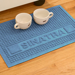 Frontgate - WATER & DIRT SHIELD ™ Personalized Squares Pet Mat - Anti-static 100% premium polypropylene fibers. Rubber-reinforced face nubs keep raised pile from crushing. Non-skid rubber backing. Resists mildew, shedding, and fading for years. Dries quickly and will not rot. Our Water & Dirt Shield Squares Pet Mat protects the floors while your pets nibble on food and drink. The unique raised square design removes dirt and moisture, and helps to trap it in the mat's lower profile.  .  .  .  .  . Suitable for all floor types. Personalization included, up to 10 uppercase letters . Vacuum or hose clean . Note: Do not place on wet floors. Made in USA. Please note, personalized items are nonreturnable.