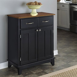 HomeStyles - 36 in. Buffet Server - A buffet is the perfect storage and service piece that will also add bold style to any dining area. A black finish can blend with many types of decor and the understated lines of this cabinetry are classic and highlighted by the top in a cottage oak finish. * Cottage oak top. Two utility drawers. Two wood framed cabinet doors. Adjustable shelf for plenty of inside storage. Brushed steel hardware. Made from Asian hardwood. Black finish. Made in Thailand. 29.25 in. W x 15.87 in. D x 36 in. H. Assembly InstructionsThe cabinet is equipped with adjustable floor levelers. Home styles buffet-of-buffets is an expansive collection of buffets designed to provide added storage and workspace for the kitchen and dining areas of the home.
