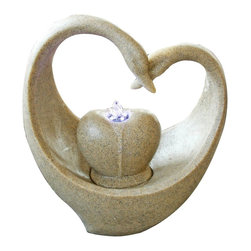 Yosemite Home Decor - Yosemite Home Decor Swan Rock Contemporary Indoor Fountain X-26190WC - Two swan heads become entwined, recreating the classic and beloved heart shape on this Yosemite Home Decor indoor fountain. This contemporary fountain, Swan Rock, also features a center stone with coordinating shaping. Sandy Brown tones add versatility and a modern LED light completes the look.
