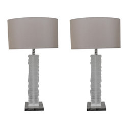 Porta Romana - Consigned Porta Romana Strata Lamps - An individually carved cast glass column cuts a dramatic figure in Porta Romana's Strata lamps. This unusual base gorgeously reflects light. A taupe silk shade and nickel base completes the look. Requires one 100-watt 3 way bulb type A 19 medium base. Sold in a set of two. In like new condition. Manufactured in UK, 2014. UL Listed.
