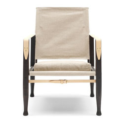 Kaare Klint Safari Chair - The Kaare Klint Safari Chair is one of the first do-it-yourself high design pieces: it can easily be assembled and disassembled without tools, making it ideal for being on the move. Klint designed his Safari Chair in 1933 and was inspired by the English officers chair he had seen in a travel guide from Africa to create a lightweight, portable armchair.