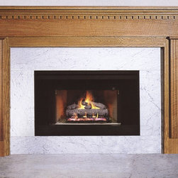 Wood Fireplace Mantel - A unique offset on the breast plate give this mantel a distinctive look.