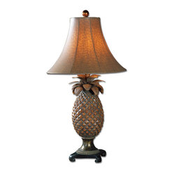 Uttermost - Anana Table Lamp - No welcome mat? Planting this pineapple lamp on a table in your foyer will do! A long time symbol of hospitality and friendship, the pineapple has become a favorite motif for artisans. With a hand-rubbed espresso glaze with bronze accents and a matching bell shade, this pineapple lamp makes a sweet addition to any room.