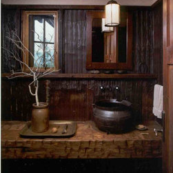 YT Custom Shop - The vessel sink sets on a hewn slab, wall mounted counter.