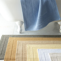"Matouk - ""Cielos"" Bath Rug 24"" x 36"" - WHITE - Matouk""Cielos"" Bath Rug 24"" x 36""HighlightsAs well made as they are beautiful to behold these textured-cotton bath rugs are an essential addition to any bath. Made in Portugal of 100% cotton.Machine wash.Available in your choice of Ivory White Butter Linen Bronze Steel or Sky Blue (listed front to back); select color when ordering.24"" x 36"".Designer About Matouk:The son of a jeweler John Matouk understood the principles of fine workmanship and quality materials. After studying fine fabrics in Italy he founded Matouk in 1929 as a source for fine bed and bath linens. Today the third generation of the Matouk family guides the company whose headquarters were relocated to the United States from Europe during World War II. Matouk linens are prized worldwide for their uncompromising quality and hand-finished detailing by skilled craftsmen."