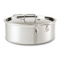 All Clad - All Clad MC2 Stockpot, 8 qt. - MC2 cookware is a contemporary makeover of All-Clad's original Master Chef collection, created for the chef community. Embodying a commercial aesthetic and bonded three-ply construction, MC2 cookware is lightweight and hardworking, making it perfect for the professional chef or culinary enthusiast who craves industrial style and professional performance. The 18/10 stainless steel interior complements a matte-finished, brushed aluminum exterior, providing superior cooking results at an extraordinary value.                              -Two heavy layers of aluminum increase heating speed