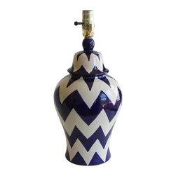 Zigzag Lamp - Wise design lovers know that statement lamps are a must-have — being beautiful and functional all at once. Step up your game with this gorgeous lamp from Talavera Vazquez. Its curvy lines and thick chevron pattern are impressive enough to stand alone, but it also looks great paired with your favorite accessories.