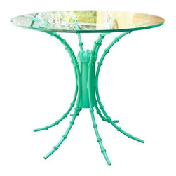 Pre-owned Turquoise High Gloss Iron Table - An attractive vintage turquoise iron table with a high gloss finish and a glass top. This table will be sure to add style to any Mid-Century or Hollywood Regency style room.