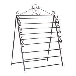 """Holly & Martin - Evelyn Easel/Wall Mount Craft Storage Rack, Black - The perfect solution for storing your wrapping paper and tissue paper this easel is a must have for any craft room. Featuring a beautiful scroll work design this easel can hold up to six standard 30"""" rolls of wrapping paper and has two additional racks to hang tissue paper on. This easel also conveniently converts to a wall mount storage unit to fit your needs. Add one to your home today!"""