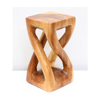 Kammika - Mini Vine Twist Stool 4x4x7.5 inch H Sust Wood in Eco Friendly Livos Clear Oil F - Our Sustainable Monkey Pod Wood Mini Vine Twist Stool 4 inch x 4 inch x 7.5 inch height in Eco Friendly, Natural Food-safe Livos Clear Oil Finish presents with graceful legs that stretch and curve from base to top - in the manner of tree vines. These sturdy, versatile eco friendly functional art pieces are intricately carved small versions of some of our stool and stand designs. You can use as computer speaker stands or as display window stands for jewelry and other small objects. Finished in Livos Clear Oil allows you to see the wood naturally darken with age. Made from the branches of the Acacia tree in Thailand - where each branch is cut and carved to order (allowing the tree to continue growing), the wood is kiln dried, carved and sanded by local artisans. They are then rubbed in Livos Clear tone oil creating a water resistant and food-safe matte finish. These natural oils are translucent, so the wood grain detail is highlighted. There is no oily feel and cannot bleed into carpets, as it contains natural lacs. Craftspeople from the Chiang Mai area in Northern Thailand create these unique pieces with the simplest of tools. We make minimal use of electric hand sanders in the finishing process. All products are dried in solar and or propane kilns. No chemicals are used in the process, ever. After each Monkey Pod wood (Acacia, Koa, Rain Tree grown for wood carving) piece is dried, carved, and sanded, it is rubbed with Livos oil, and then packaged with cartons from recycled cardboard with no plastic or other fillers. As this is a natural product, the color and grain of your piece of Nature will be unique, and may include small checks or cracks that occur when the wood is dried. Sizes are approximate. Products could have visible marks from tools used, patches from small repairs, knot holes, natural inclusions or holes. There may be various separations or cracks on your piece w