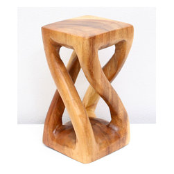 Kammika - Mini Vine Twist Stool 4x4x7.5 inch H Sust Wood in Eco Friendly Livos Clear Oil F - Our Sustainable Monkey Pod Wood Mini Vine Twist Stool 4 inch x 4 inch x 7.5 inch height in Eco Friendly, Natural Food-safe Livos Clear Oil Finish presents with graceful legs that stretch and curve from base to top - in the manner of tree vines. These sturdy, versatile eco friendly functional art pieces are intricately carved small versions of some of our stool and stand designs. You can use as computer speaker stands or as display window stands for jewelry and other small objects. Finished in Livos Clear Oil allows you to see the wood naturally darken with age. Made from the branches of the Acacia tree in Thailand - where each branch is cut and carved to order (allowing the tree to continue growing), the wood is kiln dried, carved and sanded by local artisans. They are then rubbed in Livos Clear tone oil creating a water resistant and food-safe matte finish. These natural oils are translucent, so the wood grain detail is highlighted. There is no oily feel and cannot bleed into carpets, as it contains natural lacs. Craftspeople from the Chiang Mai area in Northern Thailand create these unique pieces with the simplest of tools. We make minimal use of electric hand sanders in the finishing process. All products are dried in solar and or propane kilns. No chemicals are used in the process, ever. After each Monkey Pod wood (Acacia, Koa, Rain Tree grown for wood carving) piece is dried, carved, and sanded, it is rubbed with Livos oil, and then packaged with cartons from recycled cardboard with no plastic or other fillers. As this is a natural product, the color and grain of your piece of Nature will be unique, and may include small checks or cracks that occur when the wood is dried. Sizes are approximate. Products could have visible marks from tools used, patches from small repairs, knot holes, natural inclusions or holes. There may be various separations or cracks on your piece when it arrives. There may be some slight variation in size, color, texture, and finish color.Only listed product included.