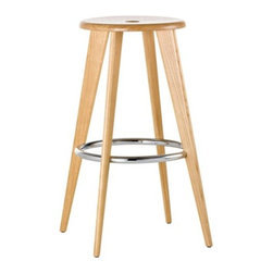 Vitra - Tabouret Haut Stool by Vitra - Inspired by the archetypal bar stool, the Vitra Tabouret Haut Stool has a smooth, round oak seat atop four solid oak legs. The chromed tubular footrest gives feet a place to rest, adds a bit of bling and keeps the canted legs strong and stable. Originally designed in 1942 by Jean Prouve. Founded in Switzerland in 1950, Vitra produces intelligent and inspiring furniture and accessories for the home, office and other public spaces. Ever mindful of the importance of sustainability in design, Vitra creates furnishings with high quality and versatile style that ensures functional and aesthetic enjoyment for the long term.