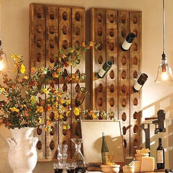 "Decorative French Wine Riddling Rack - We fell in love with the look of old champagne riddling racks as display. We've mounted our rack away from the wall for an artful array of empty bottles - fine vintages, beautiful labels and bottles just too beautiful to throw away. Place it above an entertainment console, or group several for a unique arrangement. 21.5"" wide x 3.5"" deep x 57.5"" high Made of mango wood with rustic knotty finish. Maximum weight capacity, 60 pounds or 10 filled bottles. Sold in units of one. Catalog / Internet only."