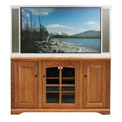 Eagle Furniture Manufacturers - Oak Ridge 3 Doors Entertainment Console (Medium Oak) - Finish: Medium Oak. One arched glass panel door. Two adjustable wood shelves. Two raised panel doors. Two fixed wood shelves. Designed with decorative molding and fluted detailing. Warranty: Eagle's products are guaranteed against material defects for one year from date of delivery to the dealer. Made in USA. No assembly required. 55 in. W x 17 in. D x 32 in. H (106.3 lbs.)The Oak Ridge collection combines American oak hardwood with updated contemporary styling. Heavy crown molding, sleek lines, fluted side molding, black brushed metal hardware, solid oak frames and solid oak recessed doors give this transitional collection a style all its own