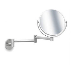 Primo Wall-Mounted Cosmetic Mirror by Blomus - Put your face on with the double magnification of this wall-mounted stainless steel makeup mirror. It's stylish and will not take up any valuable counter space.