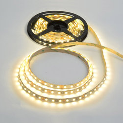 Edge Lighting - Soft Strip 2.4W 12V Very Warm White - Soft Strip 2.4W (SS3) 12V is ideal for inside cabinets, wine cellars, steps, behind mirrors, handrails, inside drawers, niches, and toe kick application. SS3 uses 2.4 watts of LED per foot, with 2540K color temperature, and 65-70 CRI. It is a flexible copper strip that is less than .5 inch wide with an optically clear protective coating. It is sold in 1 foot increments up to 25 feet with easy plug-in connectors on each end to join sections together. Also available in a smaller 2 inch segments. Custom lengths can be made either by joining small segments together or easily trimming the soft strip with scissors. Once trimmed, no additional segments may be added. Plug-in flexible connectors are available for making turns and custom configurations. Easy to install, the SS3 features 3M sticky back tape on back of the strip, or may be installed with screw-in mounting clips, sold separately. A power supply is required, sold separately. Dimmable with a low voltage electronic dimmer (recommended Lutron Diva DVELV-300P, Lutron Skylark SELV-300P, or Lutron Maestro MAELV-600).  Rated for indoor applications. SS3 includes a flexible aluminum heat sink. Maximum length before re-feeding is 25 feet. ETL listed. Limited Quantities Available. Please call for more information.