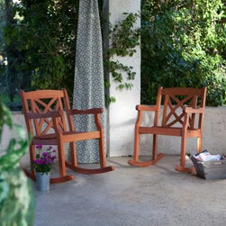 Pair of Magnolia Rocking Chairs - Featuring a beautiful, casual style enhanced by a natural light wood finish, the Pair of Magnolia Rocking Chairs have a durable acacia construction to last for years. Perfect for any porch or patio, these chairs will give you a comfortable place to visit or enjoy the view.