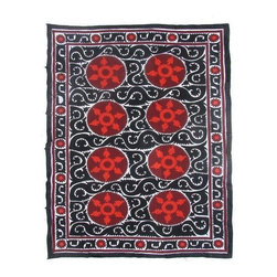Pre-owned Vintage Red & Black Suzani - This vintage Suzani will add an incredible focal point to your home decor. This one-of-a-kind vintage Suzani was handmade in Uzbekistan during the 2nd half of the 20th century.    Vintage Suzanis from Uzbekistan have origins as storied as the motifs that cover their surface. Rich in symbolism, Suzanis contain geometric patterns, flowers, and other natural elements, which all hold meanings that are embroidered into stylized shapes that vary according region, tribe, family, and the artisans. Suzanis from Nurata, Samarkand, Bukhara, Shahrisyabz, Tashkent, and Fergana, for example, all differ with respect to color, material, pattern, and the type of stitches used. Even the colors impart a deeper meaning: yellows and oranges represent knowledge; red means fire and sun, blues embody the sky, and greens from the usma plant represent spring and youth.